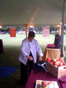 Chef Ann Smiles as she puts on her Whole Foods Chefs Jacket and Prepares to Talk about School Lunch.