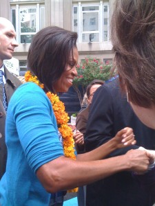 Those eyes! Those arms! It's First Lady Michelle Obama, a few inches away from me, shaking hands at the opening of the FRESHFARM Markets by The White House.